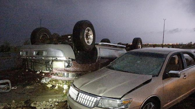 Cars that were damaged by a tornado in parking lot at Canadian Valley Technical Center on State Highway 66, west of Banner Road, Friday May 31, 2013 in El Reno, Okla. (AP Photo/The Oklahoman, Jim Beckel) LOCAL STATIONS OUT (KFOR, KOCO, KWTV, KOKH, KAUT OUT); LOCAL WEBSITES OUT; LOCAL PRINT OUT (EDMOND SUN OUT, OKLAHOMA GAZETTE OUT) TABLOIDS OUT