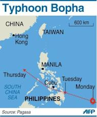 Graphic showing the path of Typhoon Bopha, packing gusts of 210 kilometres an hour. A total of 145 flights to and from Mindanao and the central islands had been grounded since Monday night and more than 3,000 ferry passengers were stranded as vessels were ordered to stay in port, the civil defence office said.