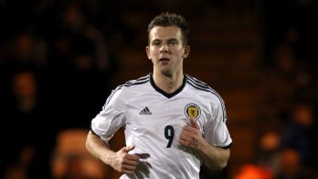World Football - Rhodes double helps Scotland scrape win