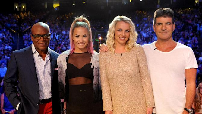 "This June 2012 photo released by FOX shows judges, from left, L.A. Reid, Demi Lovato, Britney Spears and Simon Cowell on the set of ""The X Factor."" The contest between ""The Voice"" and ""The X Factor"" is escalating after NBC scheduled its ""Voice"" against Wednesday's second-season debut of Fox's ""X Factor.""  (AP Photo/FOX, Ray Mickshaw)"