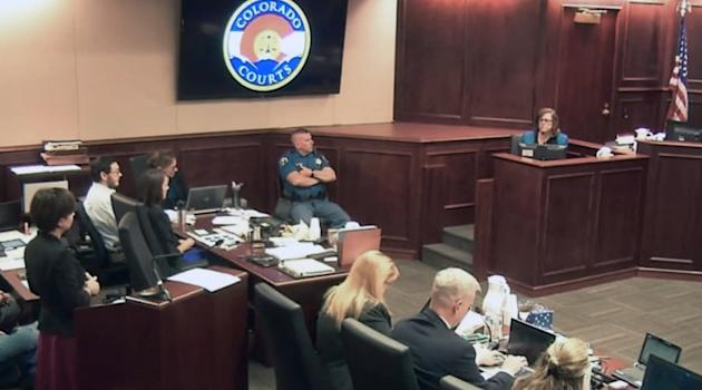 In this image made from Colorado Judicial Department video, Arlene Holmes, top right, the mother of James Holmes, second from left, in white shirt, gives testimony during the sentencing phase of the C