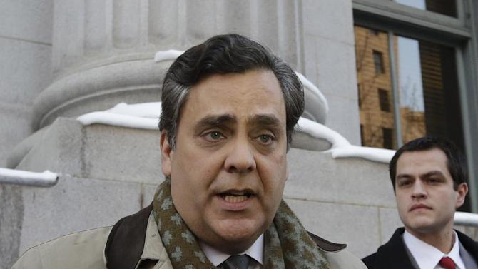 """Jonathan Turley, attorney for Kody Brown and his four wives, the stars of the reality show """"Sister Wives,"""" talks with reporters following a hearing on whether Utah can prohibit plural marriage, Thursday, Jan. 17, 2013, in Salt Lake City. (AP Photo/Rick Bowmer)"""