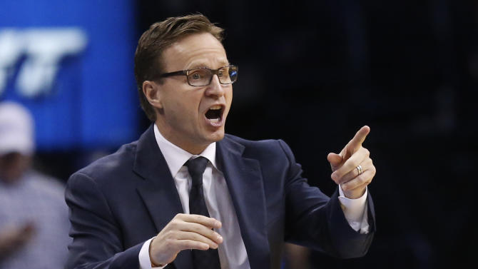 Oklahoma City Thunder head coach Scott Brooks shouts to his team in the second quarter of an NBA basketball game against the Sacramento Kings in Oklahoma City, Sunday, Jan. 19, 2014