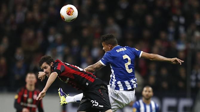 Frankfurt's Tranquillo Barnetta of Switzerland, left, and Porto's Danilo challenge for the ball during a Europa League round of 32 second leg soccer match between Eintracht Frankfurt and FC Porto in Frankfurt, Germany, Thursday, Feb. 27, 2014