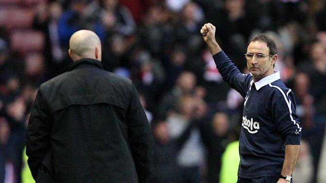 Sunderland's manager Martin O'Neill, right, celebrates his victory over Blackburn, at the end of their English Premier League soccer match at the Stadium of Light, Sunderland, England, Sunday, Dec. 11, 2011. (AP Photo/Scott Heppell)