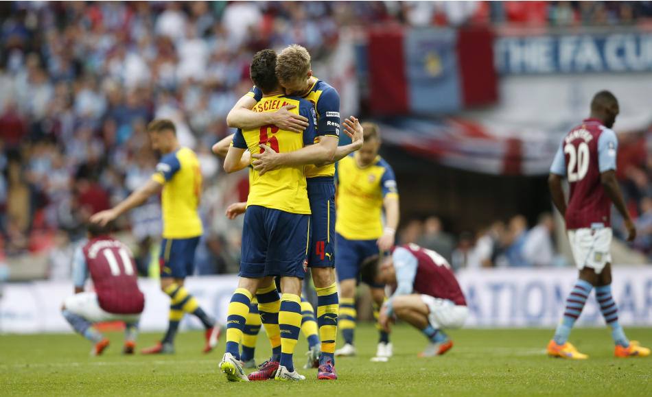 SOC: Arsenal's Per Mertesacker and Laurent Koscielny celebrate at the full time whistle after winning the FA Cup Final