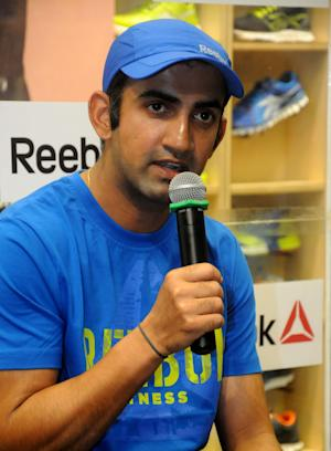 Indian Cricketer Gautam Gambhir interacts with media during inauguration of a sports goods manufacturing company's outlet in Kolkata on Oct.25, 2013. (Photo: IANS)