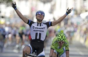 Giant-Shimano team rider Kittel of Germany celebrates as he wins the first 190.5 km stage of the Tour de France cycling race from Leeds to Harrogate