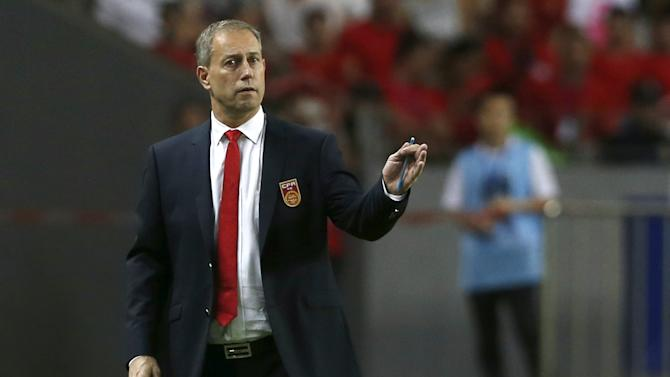 China's coach Alain Perrin reacts during World Cup qualifying match against Hong Kong in Shenzhen