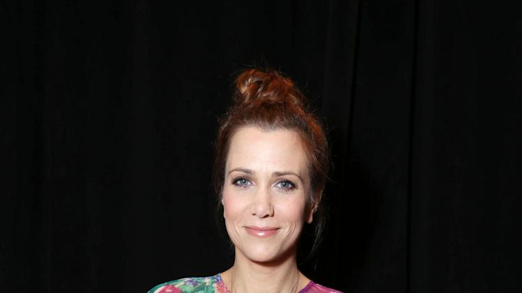 "Kristen Wiig, cast member in the upcoming film ""The Secret Life of Walter Mitty"" at the 20th Century Fox Presentation at 2013 CinemaCon, on Thursday, April, 18th, 2013 in Las Vegas. (Photo by Eric Charbonneau/Invision for 20th Century Fox/AP Images)"