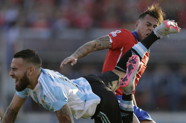 Chile's Vargas gets a kick in the face from Argentina's Otamendi during their Copa America 2015 final soccer match at the National Stadium in Santiago