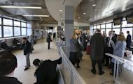 """Some of the 1,000 lobbyists, business owners and politicians gather at the Trenton train station before boarding a train to Washington, D.C., Thursday, Feb. 16, 2017 in Trenton, N.J. The state Chamber of Commerce's 80th annual trip — nicknamed the """"Walk to Washington"""" because rail riders generally pace the train's corridors schmoozing and handing out business cards — comes after a national election that hinged in part on repudiating insiders and establishment politics. (AP Photo/Mel Evans)"""