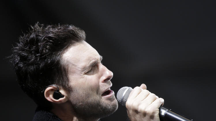 Adam Levine performs with Maroon 5 at the New Orleans Jazz and Heritage Festival in New Orleans, Friday, May 3, 2013. (AP Photo/Gerald Herbert)