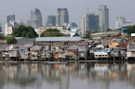 A slum area is backdropped with the Manila skyline in 2007. The World Bank raised its 2012 growth forecast for the Philippines Thursday following a stronger-than-expected start to the year, but warned of headwinds from the crisis in Europe and a Chinese slowdown
