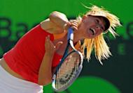 Maria Sharapova of Russia, seen here in action against Shahar Peer of Israel during Day 4 of the Sony Ericsson Open at Crandon Park Tennis Center in Key Biscayne, Florida. Sharapova advanced to the third round of the $9.6 million WTA and ATP hardcourt tournament by rallying to defeat Peer 4-6, 6-3, 6-3
