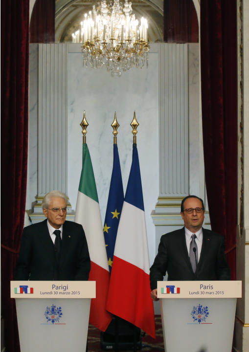 Italian President Sergio Mattarella, left, and French President Francois Hollande, right, address the media at the Elysee Palace in Paris, France, Monday, March 30, 2015. The two Presidents spoke abou