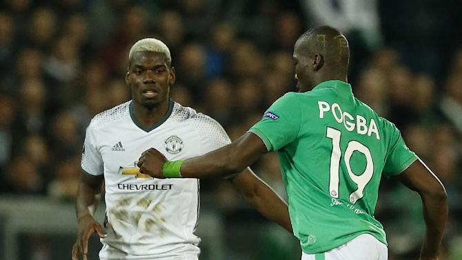 Manchester United's Paul Pogba in action with St Etienne's Florentin Pogba
