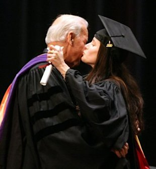 Ashey Biden gives her dad, Vice President Joe Biden, a kiss after receiving her master's degree at the University of Pennsylvania's School of Social Policy and Practice in May 2010. (Photo: Charles Fox/AP)