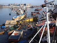 Sunken fishing boats are seen on April 2, 2014 at the Riquelme Cove, in Iquique, northern Chile, after a powerful 8.2-magnitude earthquake hit off Chile's Pacific coast