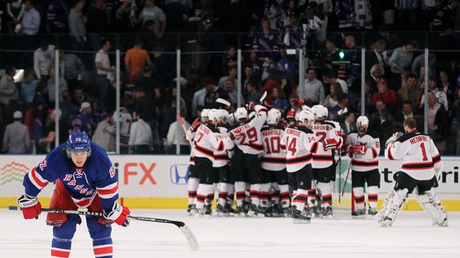 Carl Hagelin #62 Of The New York Rangers Skates Away Dejected As The New Jersey Devils Celebrate Thier 3 To To Win In Getty Images