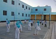 """File photo of female Afghan prisoners playing volleyball at a prison in the eastern Afghan city of Herat. Hundreds of Afghan women are languishing in prison having been accused or convicted of so-called """"moral crimes"""", including """"running away"""" and having sex outside marriage, campaign group Human Rights Watch said March 27, 2012"""
