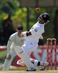 Nuwan Kulasekara tries to avoid a bouncer from Tim Southee in Colombo on Wednesday. Southee, who took five wickets in the first innings, continued to trouble the Sri Lankan batsmen