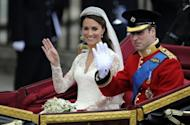 Prince William and his wife Catherine, Duchess of Cambridge, wave to crowds in the 1902 State Landau carriage in London on their wedding day on April 29. The couple celebrate their first wedding anniversary on Sunday