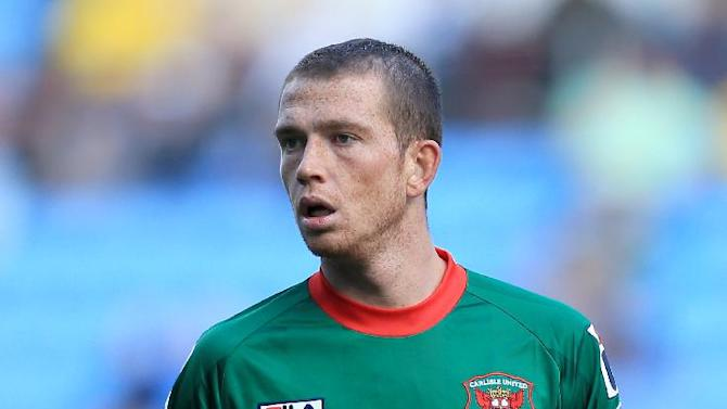 Joe Garner will stay with Carlisle United for another month