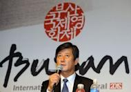Lee Yong-Kwan, director of the Busan International Film Festival, speaks during a press conference in Seoul. A Hong Kong action-thriller and a rural drama from Bangladesh will open and close Asia's top film festival next month, as its South Korean hosts look to share more of the spotlight with regional offerings