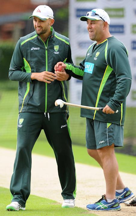 Australia's Nathan Lyon, left, and Australia Head Coach Darren Lehmann during net practice in preparation the third Ashes Test cricket match, against England at Edgbaston, Birmingham, England, Tuesday