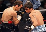 French Brahim Asloum fights against Argentinian Juan Carlos Reveco (right) during a match for the WBA World champion title in the category light flyweight in Le Cannet, southern France on 08 December 2007. Japan's Masayuki Kuroda will challenge Reveco next month