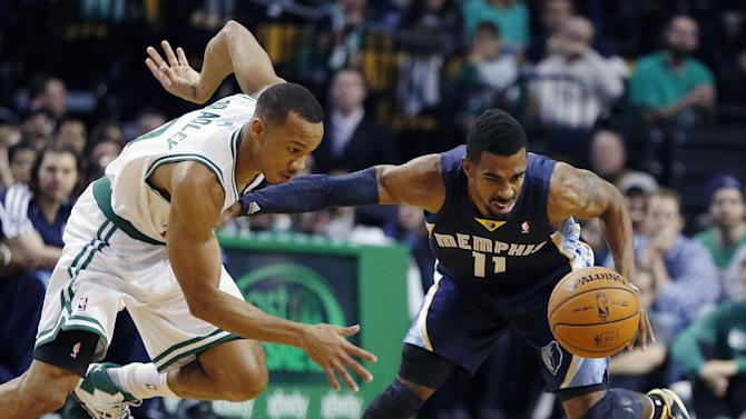 Boston Celtics' Avery Bradley (0) battles Memphis Grizzlies' Mike Conley (11) for a loose ball in the first quarter of an NBA basketball game in Boston, Wednesday, Nov. 27, 2013