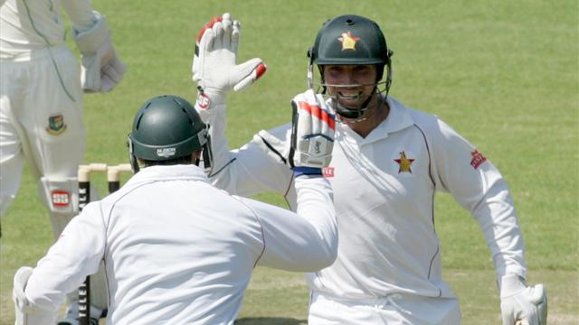 Cricket - Zimbabwe celebrate record Test win against Bangladesh