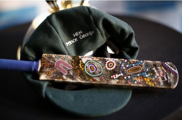 "A ""baggy green"" Australian cricketers cap and miniature bat are seen during a reception at the Sydney Opera House"