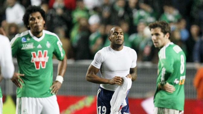 Briand of Olympique Lyon reacts after scoring against St Etienne during their French Ligue 1 soccer match at the Geoffroy Guichard stadium