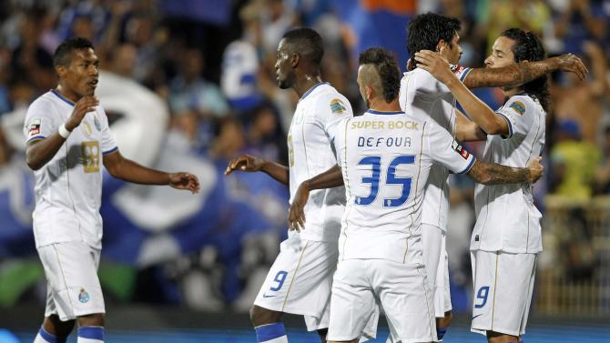 Porto's players celebrate a goal against Estoril during their Portuguese premier league soccer match in Estoril