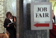 A job seeker looks over event materials as she waits to enter the San Francisco Hirevent job fair in March 2012. The United States added a meager 80,000 jobs in June, the third month of weak job creation amid a sluggish economy, official data showed Friday