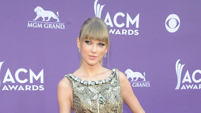 FILE - This April 7, 2013 file photo shows singer Taylor Swift at the 48th Annual Academy of Country Music Awards at the MGM Grand Garden Arena in Las Vegas. Prom season provides many girls a chance to have their moment in the spotlight. It's likely that this year's parade of fashions will include a few celebrity lookalikes. (Photo by Al Powers/Invision/AP, file)