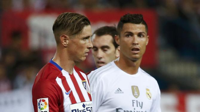 Real Madrid's Cristiano Ronaldo and  Atletico Madrid's Fernando Torres look on during their Spanish first division derby soccer match in Madrid