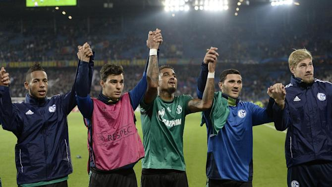 Schalke's players gesture, after winning the Champions League group E group stage soccer match between Switzerland's FC Basel and Germany's FC Schalke 04 at the St. Jakob-Park stadium in Basel, Switzerland, Tuesday, Oct. 1, 2013
