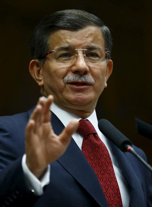 Turkey's Prime Minister Ahmet Davutoglu addresses members of parliament from his ruling AK Party at the Turkish parliament in Ankara