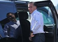 US Republican presidential candidate Mitt Romney pauses before entering his SUV after arrival in Las Vegas, Nevada