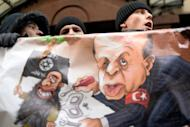 Russian protesters hold a placard and shout slogans in front of the Turkish embassy in Moscow on November 25, 2015