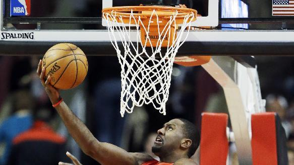 Toronto Raptors forward Patrick Patterson drives to the basket against the Chicago Bulls during the second half of an NBA basketball game in Chicago on Saturday, Dec. 14, 2013. The Raptors won 99-77