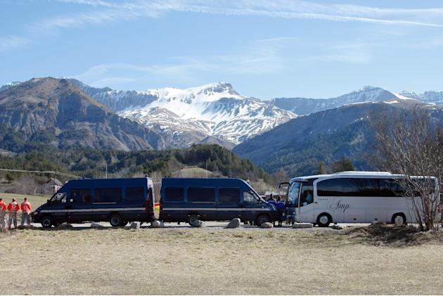 Buses of the French gendarmerie, park and mask the homage ceremony with family members of Japanese victims in the area where the Germanwings jetliner crashed in the French Alps, in Le Vernet, France,