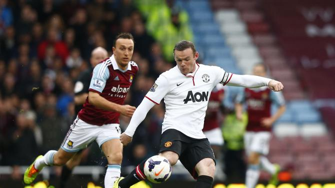 Manchester United's Rooney scores a goal against West Ham United during their English Premier League soccer match at the Boleyn Ground in London
