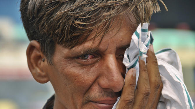 Harishanker, only one name available, whose family members went missing during their pilgrimage in Kedarnath in the northern Indian state of Uttrakhand after flash floods and landslides, wipes off his tears as he waits at the airport in Dehradun, India, Saturday, June 22, 2013. Soldiers were working to evacuate tens of thousands of people still stranded Saturday in northern India where nearly 600 people have been killed in monsoon flooding and landslides. (AP Photo)
