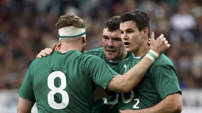 Ireland's Heaslip and Brian O'Driscoll congratulate teammate Sexton after he scored a try against France during their Six Nations rugby union match near Paris