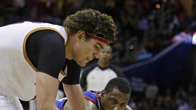 Cleveland Cavaliers' Anderson Varejao, left, from Brazil, and Philadelphia 76ers' Thaddeus Young vie for a loose ball in overtime in an NBA basketball game Saturday, Nov. 9, 2013, in Cleveland. The Cavaliers won 127-125 in double overtime