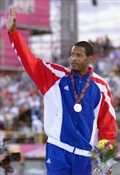 Javier Sotomayor of Cuba waves to crowd after receiving his gold medal in the high jump 30 July 1999 at the Pan American Games in Winnipeg, Canada. Sotomayor won with a jump of 2.30 meters. (ELECTRONIC IMAGE) AFP PHOTO/Jeff HAYNES